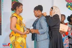 Rhobi receiving her award