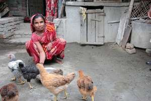 Home farmer with her hens