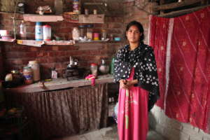 Beneficiary on PDS at home in her kitchen