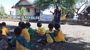 A Karkar Islander educating the young about their potential future with Seabed Mining.JPG