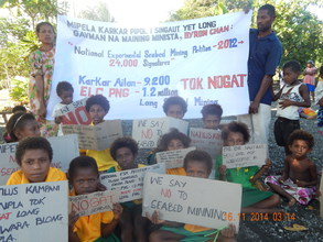 Karkar children speak their mind on seabed mining with the help of their elders.JPG