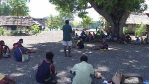 Palau (back to camera) shares seabed mining information with Karkar Islanders.JPG