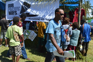 Visitors walk away from BRG stall with information and posters.JPG
