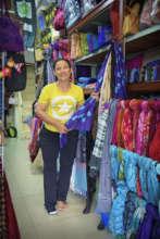 AAC artisan displaying her handicrafts.