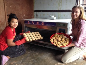 Our new mud brick oven with Kachin students