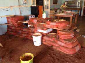 The earthen counter under construction w/ rice bag