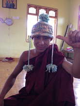 Novice monk knitting his first hat
