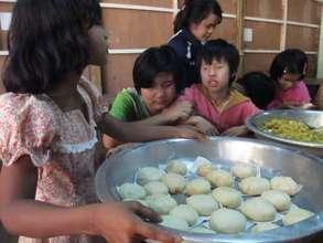 Teaching baking to children in monastery for blind