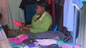 Amember of  fountain life selling Cloths in Narok