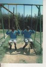 children swing during break time.