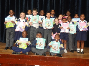 Reading Bee participants with their book prizes