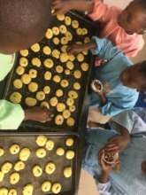 Pre-school children decorating biscuits