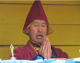 Buddhist Monk praying at Snow Leopard ceremony