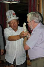 Kyrgyz Elder presents gift to big cat scientist