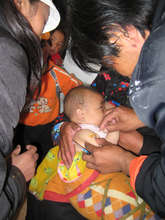Child being vaccinated in Rima