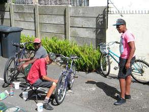 Repairing Bikes for AIDS Awareness Tour