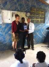 Ysaac receiving Award with Morgan and teacher