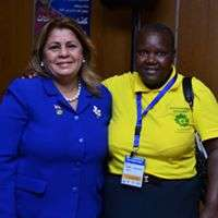 Gladys (right) at a KEWOPA FGM conference