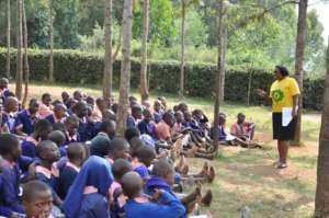 Health promoter interacting with students