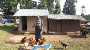 Martha smiling while feeding her chicken