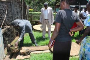 Mr. Livingstone demonstrating biogas production