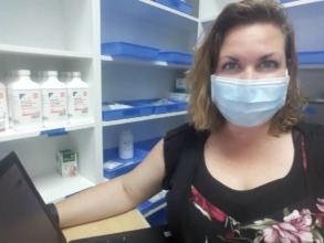 Our Nurse Coordinator in the clinic pharmacy