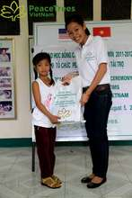 Youth receives scholarship for primary school cost