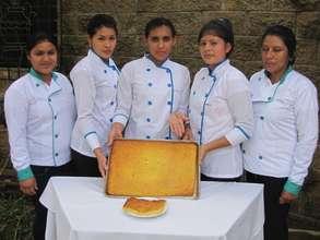 Young ladies presenting a Salvadoran pastry