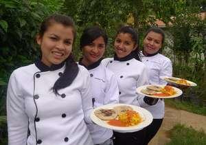 Ladies presenting a Salvadoran Traditional Dish