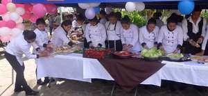Youth participating in Gastronomic Fair
