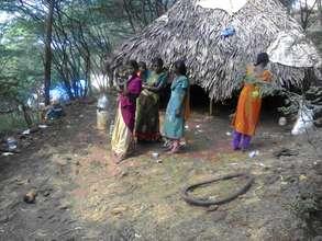 Women nearby their Hut