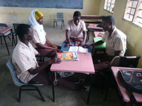 Thambo in a group discussion with his classmates