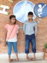 Siblings Amit and Ajita before treatment