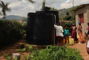Collecting water at Trust Each Other's water point