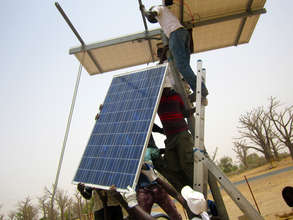 CREATE! technicians installing the solar panels