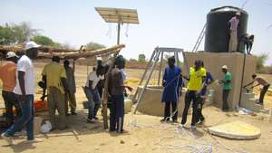 Community members & CREATE! staff install the pump