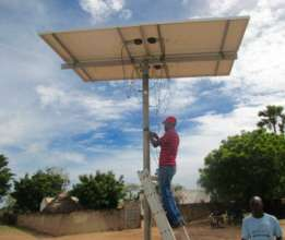 Installing the solar panel with local volunteers