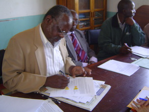 KHDP Project Manager signing grant agreement