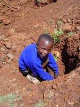 Child Planting a Tree at Kangeme Youth Centre