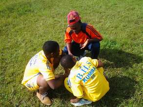 Youth Learn from one of the Coaches in Training