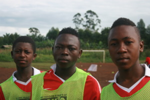 Babila (Center) with teammates