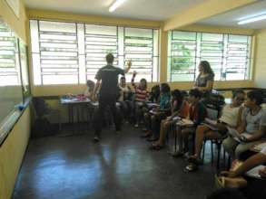 Volunteer giving the first native English class