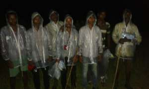 One Village Defence Party in their new rain coats