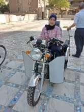 Aya on her motorcycle