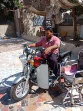 Mahmoud riding his equipped ride