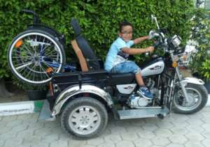 Mo Posing on his Dad's Tricycle