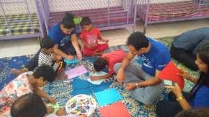 Volunteers helping the children