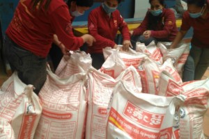 Preparing food packages to give out to families