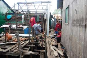 Helping poor families with house repairs