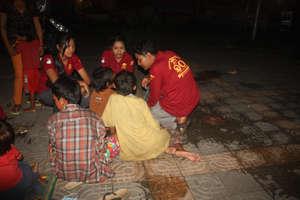 Outreach Team working night time meeting children